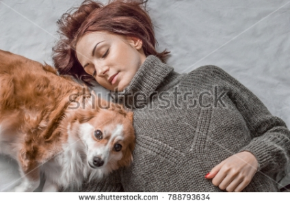 young woman looking at the dog